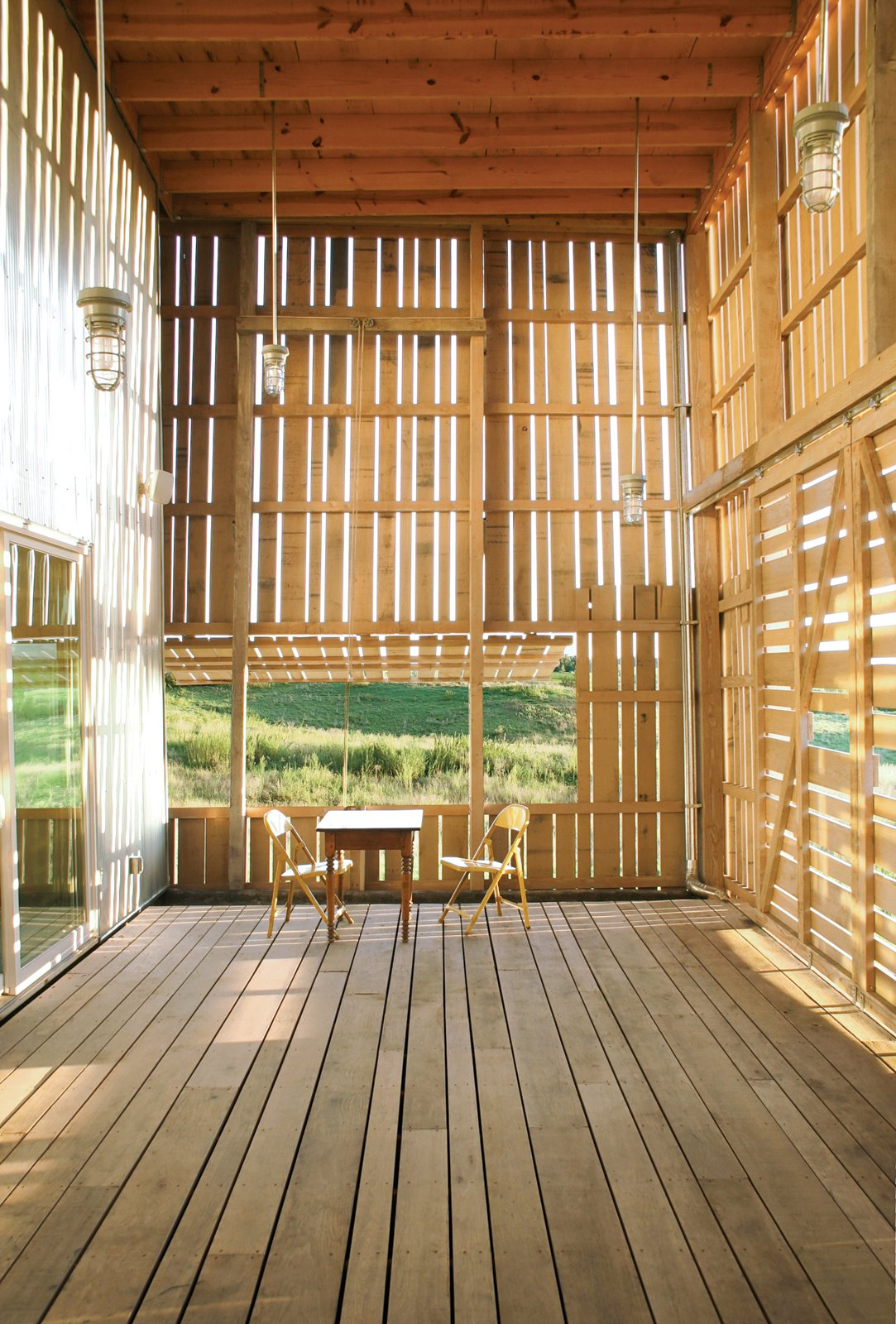 Outdoor and Wood Patio, Porch, Deck BLAIR NICHE PROJECT  At just $167 per square foot, this high-design, low-cost barn in rural Wisconsin is an American idyll.  Photos from Blair Niche Project