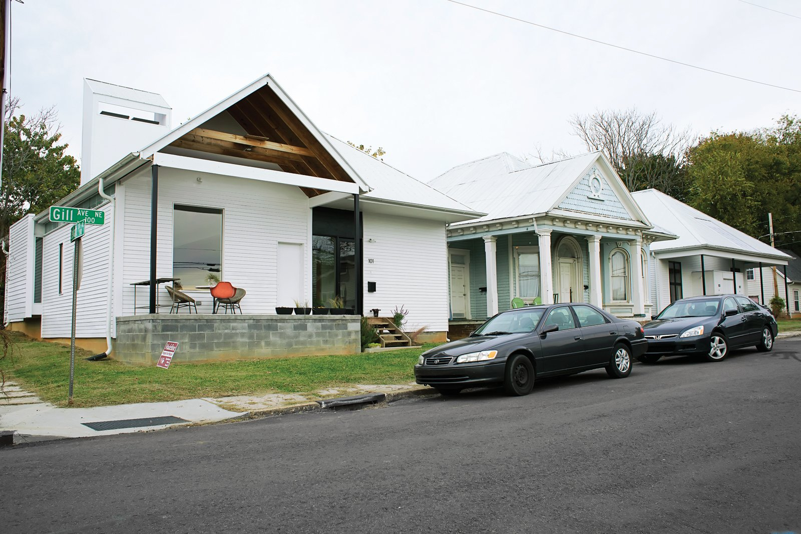 They purchased a historic duplex and bracketed it with two new houses, similar in form to the originals but wholly modern.  Photo 1 of 11 in Spirit of the South