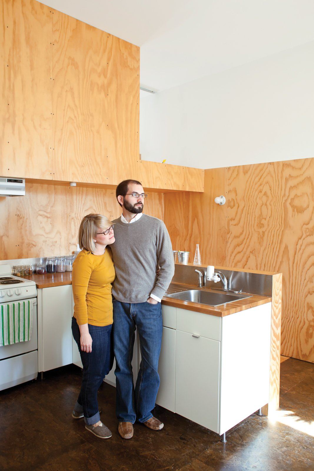 Kitchen, White Cabinet, and Wood Counter Their tenants include veterinary student Leslie Carter and intern architect Brad Raines.  Photo 4 of 11 in Spirit of the South