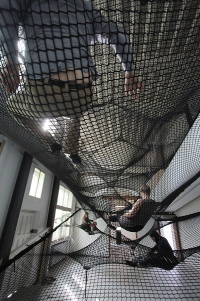 Numen's Net, occupied by gallery attendees.