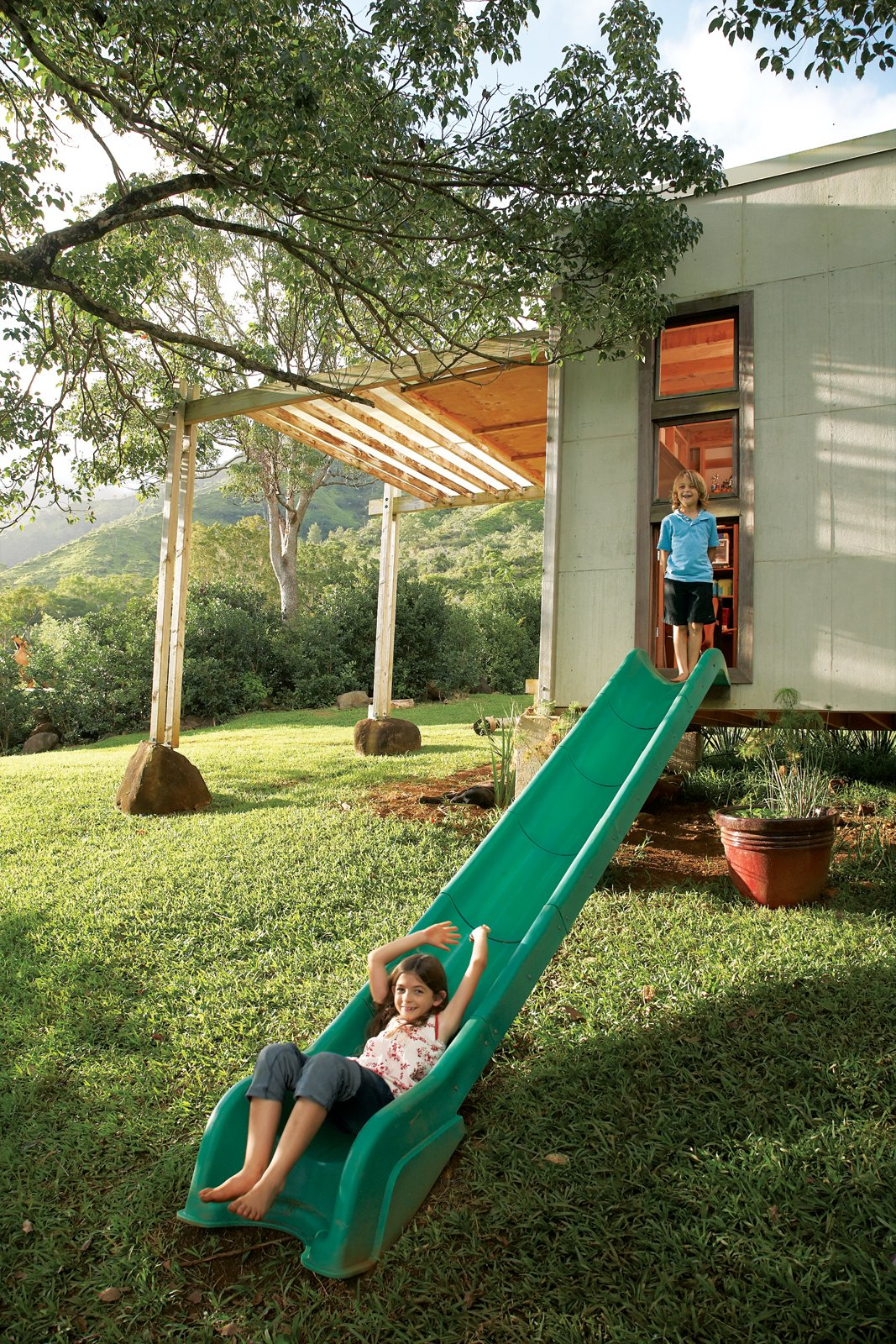 Grass, Shed & Studio, and Living Space Room Type Jackson and Zeke escape their bedroom through a slide repurposed from an old play structure. The 20-acre property backs up to nearby mountains.  Photo 10 of 22 in Grateful Shed