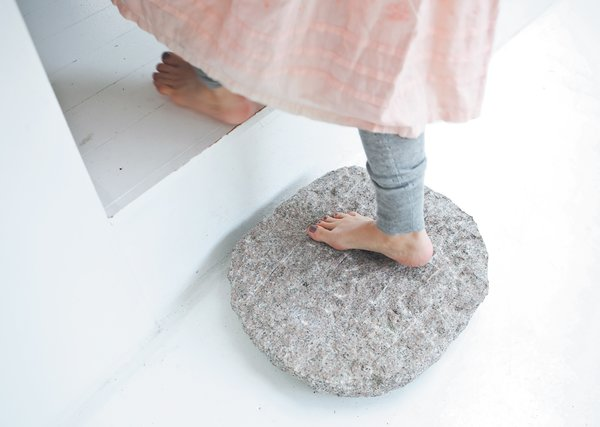 """The stepping stone, like the skylight, was inspired by zen architecture. """"In most traditional wooden houses and temples in Japan, the house is lifted above the garden, and the transition is always marked by a sculptural stepping stone,"""" says Bjerre-Poulsen. """"We used the same principle between the old house and the addition."""""""