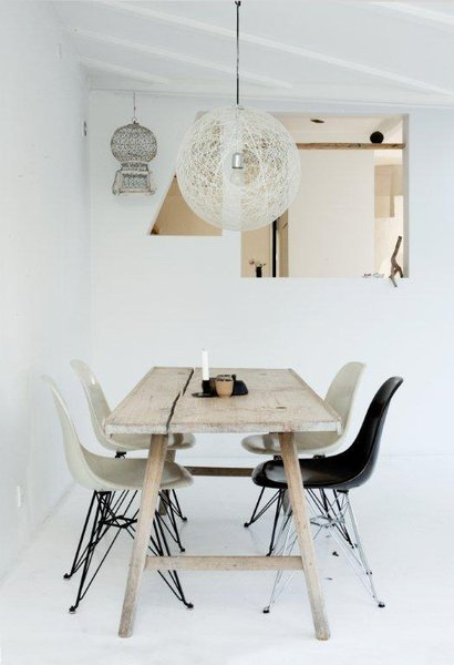 Here's the weathered wooden dining table where the family gathers for meals and conversation.