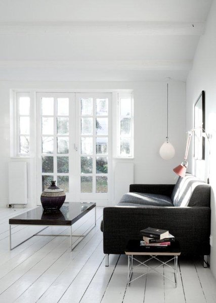French doors in the living room let light into the kitchen and open onto a lovely garden.