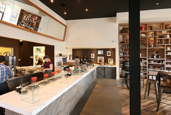 The marble counter hots a line of single-drip coffee makers and a La Marzocco Strada espresso machine at the far end. They offer single-origin beans from Africa and South America, as well as blends.