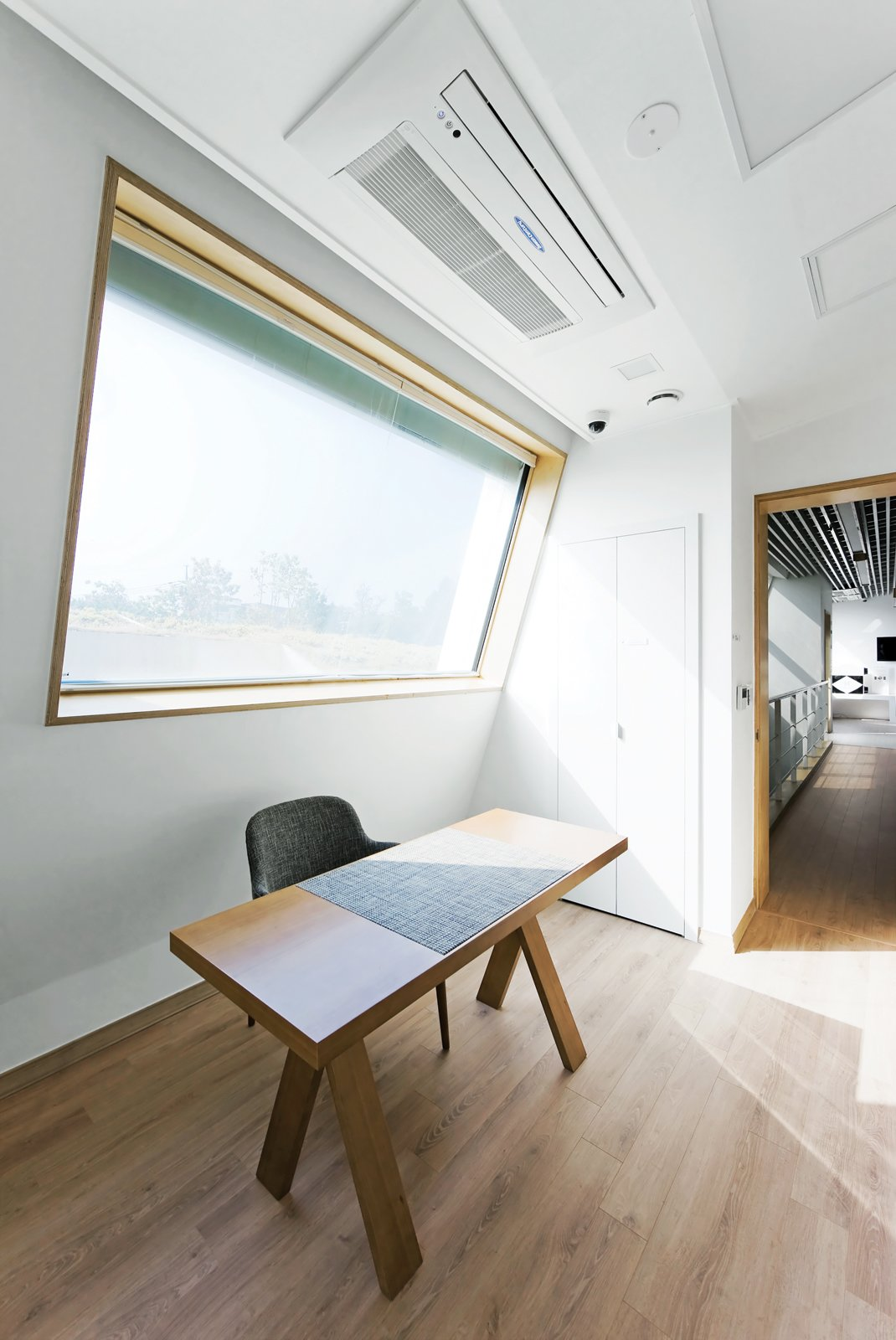 Just Venting  Though a tight thermal envelope is critical to the E+ Home's sustainability,   Kolon's heat recovery ventilation and air filtration systems (above the desk) help ease the load.  Photo 4 of 10 in Modern Green Concept House in South Korea