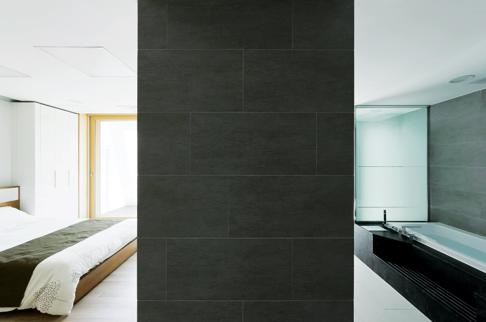 """Serenity now  Designed to suit all the needs of a Korean family of four, the interior takes what   Unsangdong calls """"emotional design"""" as seriously as energy efficiency. This tranquil ground-floor bedroom and bath were created with the help of Japanese interior designer Kondo Noriko.  Photo 7 of 10 in Modern Green Concept House in South Korea"""