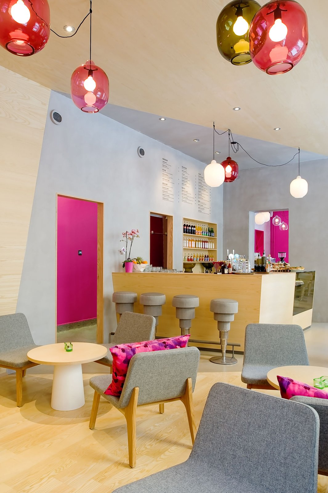 """As you can see from the bright accents of powder blue and Barbie pink, the interior is meant to elicit a strong response. According to Note, owner Michael Toutoungi said that he wanted a space that """"people either love or hate and that nobody is indifferent to."""" The aesthetic is definitely stronger and more playful than most cafe's I've visited.  Photo 14 of 21 in The Pantone Choice: Top 10 Colors for Spring 2017 from Coffee Break: Stockholm's Cafe Foam"""