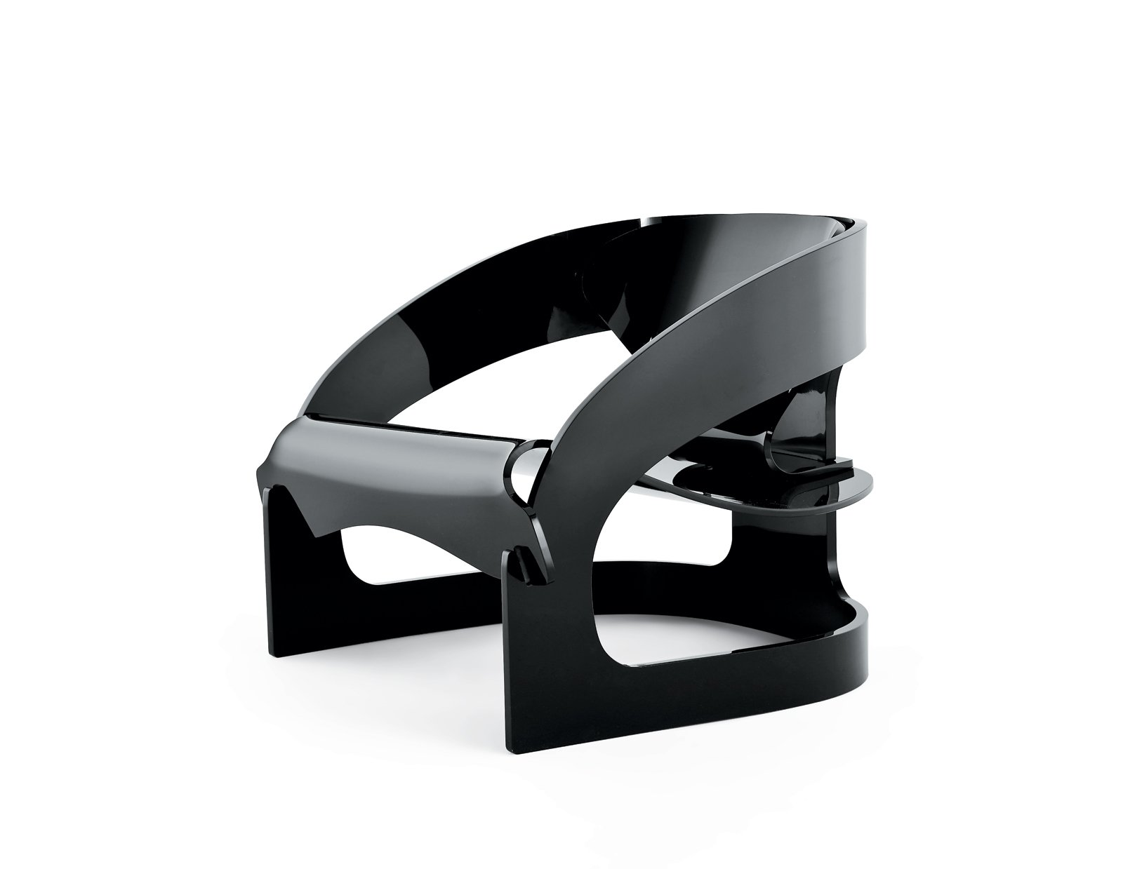"""The design has been reproduced in black, white, and crystal-clear plastic in the same proportions as Colombo's original, a process that Kartell treated with reverence, according to CEO Claudio Luti: """"We have been reluctant to approach re-editions because they may not be respectful of the original. This new chair is just the right balance between celebrating the past and making it topical in today's world.""""  Search """"joe colombo 4801 armchair"""" from Back to the Future"""