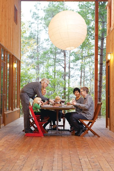 The large wraparound porch links the two main houses and two guest cabins, and is the site of many impromptu shared meals.
