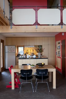 McMinn and Janzen's kitchen opens onto a double-height living and dining area.