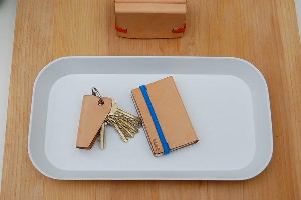 Though Eugene, Oregon-based Studio Gorm (aka John Arndt and Wonhee Jeong Arndt) is best known for their Peg series—modular furniture with swappable legs and table bases—they work at smaller scales, too. Witness their new and simple wallet and key holder, made of vegetable tanned leather and elastic.