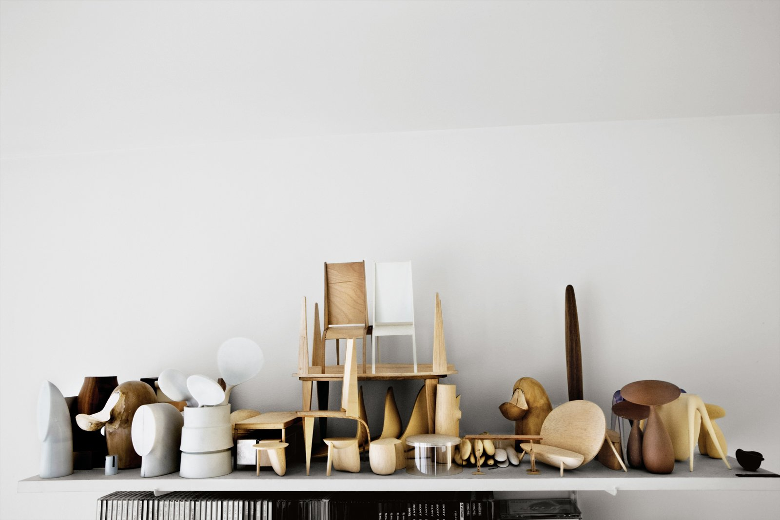 """""""Every material has its own beauty, but I'm mostly drawn to wood because of its variety of texture, smell, and color,"""" Bakker says. Maquettes made of   balsa wood and plaster are displayed in   his studio and are used as guides for skilled Dutch   or European artisans who produce the finished   pieces in silver, glass, ceramic, and copper.  Photo 1 of 9 in New Dutch Design: Aldo Bakker"""