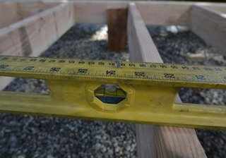 Leveling the wood framing.