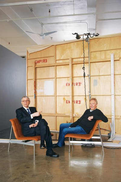 """Charles Pollock (left) and Jerry Helling (right) sit in the new CP Lounge. """"Charles was going for a Jaguar effect—the exterior of the chair is fast and has a long hood. Inside, it has all these handcrafted elements,"""" says Helling."""