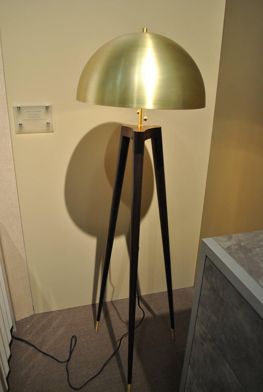 Fire Tripod lamp, with a spun-brass shade, lathe-turned legs and brass feet, by Matthew Fairbank Design.  ICFF 2012: Brass Tactics by Amanda Dameron