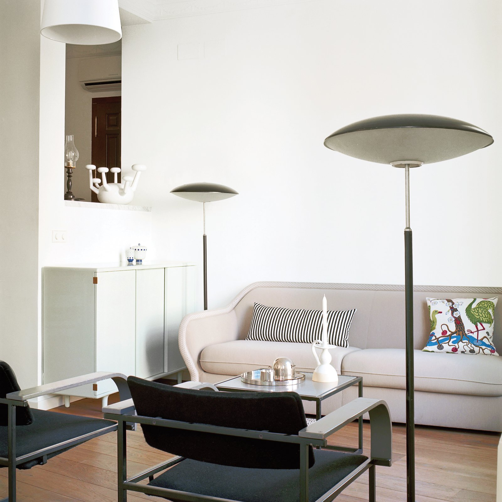 "Living Room, Sofa, Floor Lighting, Medium Hardwood Floor, and Chair Hayon and his wife, photographer Nienke Klunder, and their son, Tys, has filled his home with many of his own designs, including the Bardot sofa for Bernhardt Design and the 22 chair for Ceccotti and mint-colored armoire for Bisazza Bagno.  Photo 1 of 7 in ""A Home Should Never Feel Like a Hotel Lobby"""