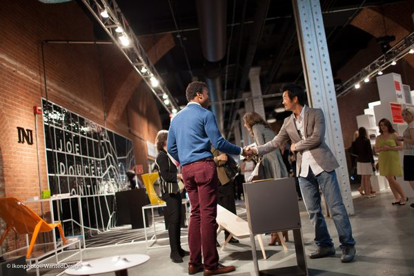 More from Wanted Design: designer Ini Archibong, greeting a visitor at his booth.