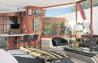 Interior designer Tracy Beckmann and furniture designer Ryan Trowbridge renovated a little-known John Lautner building in Desert Hot Springs, California. The 1947 complex consisted of four bunker-like spaces with roofs suspended from I-beams, designed for a 600-acre master-planned residential community that never came to be. An architecture aficionado at Wells Fargo understood the site's true value, believed in the project, and offered a mortgage if Beckmann and Trowbridge could pony up a 40-percent down payment on the $425,000 negotiated price. Over the next four years, Beckmann and Trowbridge set to work renovating the place, respecting Lautner's original design and intentions while coaxing the interiors into the 21st century. Hotel Lautner opened in 2011. Among its first visitors were Judith Lautner and Karol Lautner Peterson, John Lautner's daughters, who bestowed the ultimate thumbs-up on the renovation project.