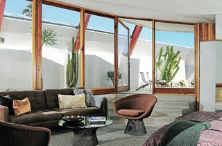 Finds included Bertoia barstools, a J. Wade Beam coffee table, and a chrome Thonet-inspired chair in Unit One and a Warren Platner coffee table and chair in Unit Four.