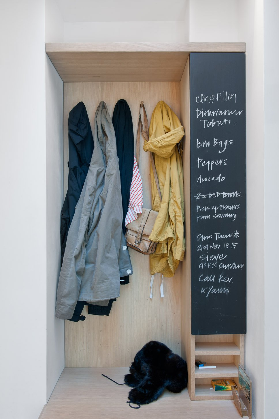 Storage Room and Closet Storage Type A built-in closet and chalkboard surface in the entry keeps things tidy and the couple's to-do list in order.  Surprising Clothing Storage Solutions by Jaime Gillin from An Obsessed Designer Fills Her Home with Vintage Finds