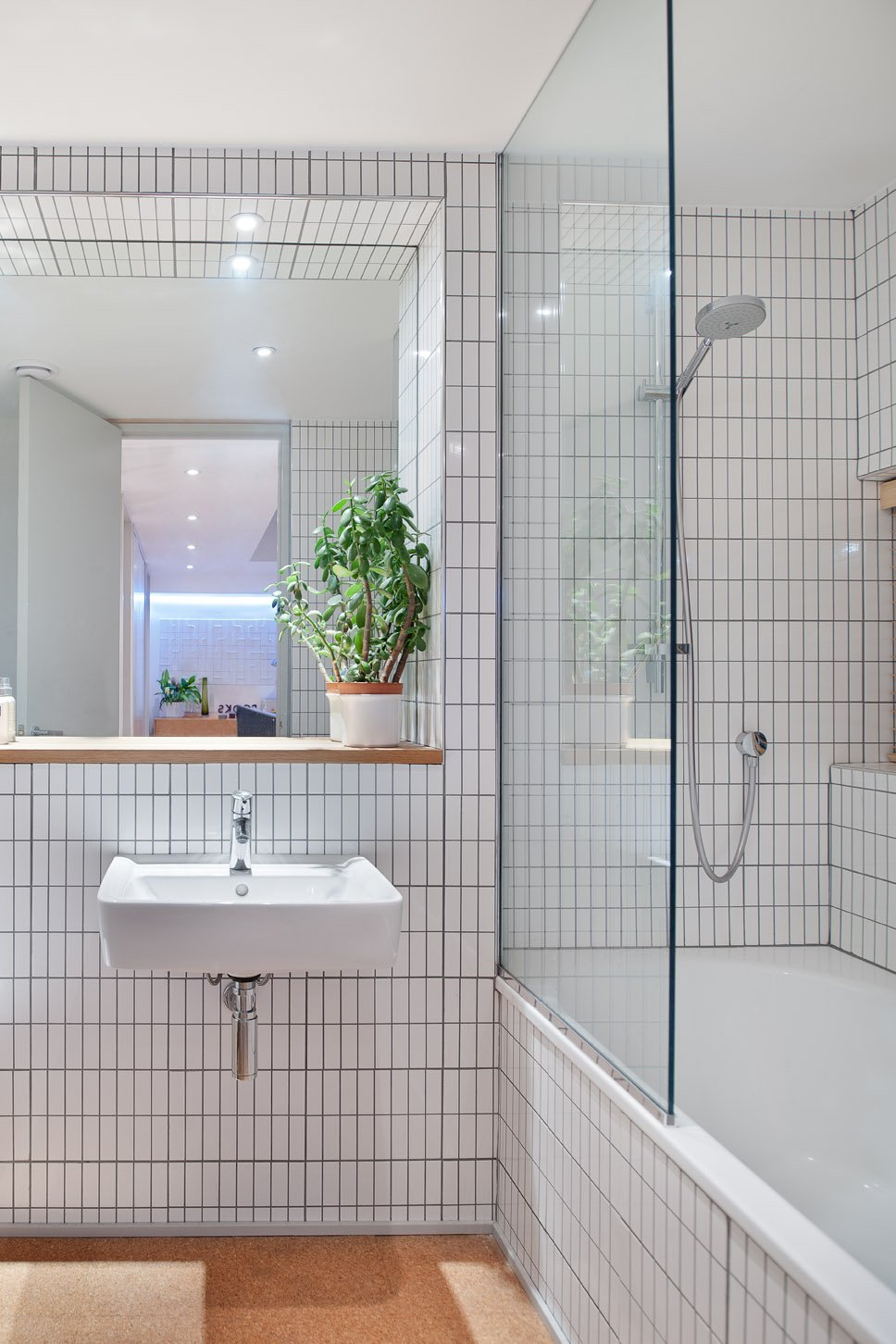 """Bath Room, Drop In Tub, and Wall Mount Sink With the freedom to do what she wanted in her own home renovation English Designer Kathryn Tyler explained, """"I put everything that I've always loved into this house,"""" including white tiles edged with gray grout in the bathroom, a design move previous clients had balked at."""
