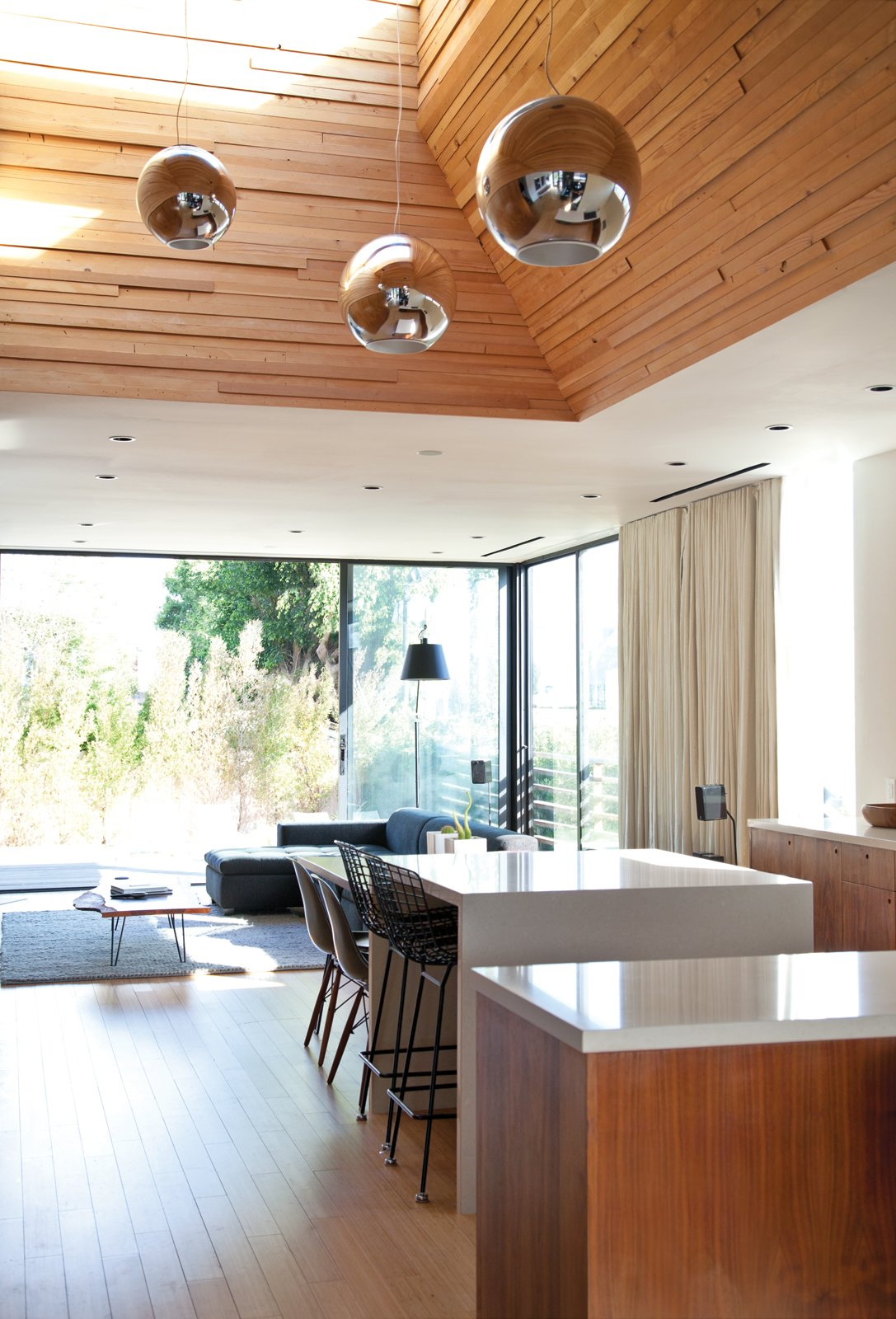 """Dining Room and Chair The Globo di Luce pendants in the kitchen are by Roberto Menghi for Fontana Arte.  Photo 8 of 9 in You Won't Be Calling This House a """"Man Cave"""""""