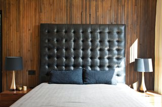 The master bedroom's massive leather headboard was Thompson's idea and design.