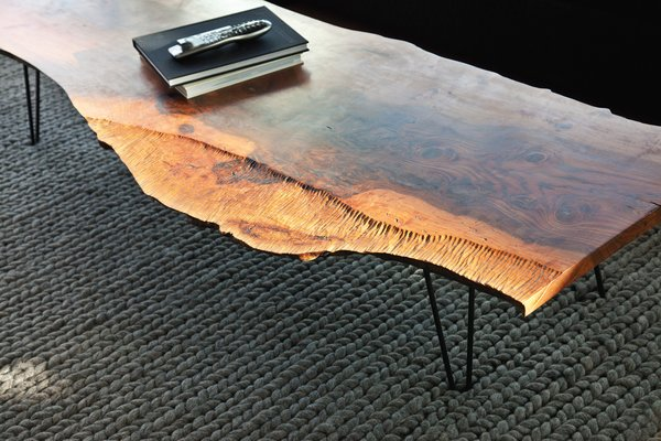 The walnut coffee table in the living room is by Samuel Moyer.