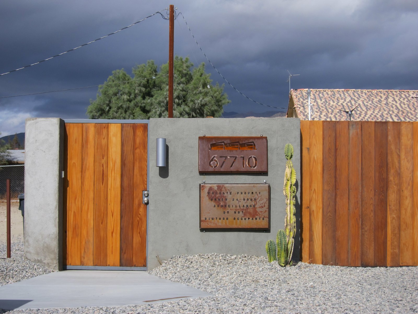 From the street, 67710 San Antonio Street in Desert Hot Springs, California, doesn't look all that exciting—though the streamlined wooden fence and jet-cut steel signage do give a hint of the modern style inside.  30+ Best Modern Fences by William Lamb from A John Lautner-Designed Hotel