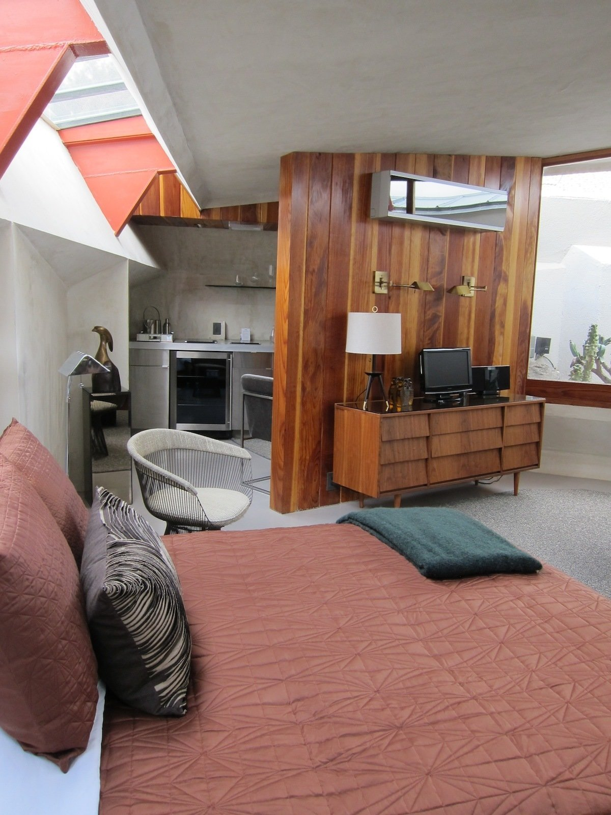 This is Unit 4, the only one with a redwood dividing wall between the kitchen and the living room (the rest have open concrete islands). Tagged: Bedroom, Storage, and Bed.  Photo 5 of 6 in The Midcentury Architecture of California Modernist John Lautner