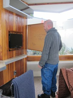 In Unit 3, the first room to be renovated, Trowbridge demonstrates a James Bond-esque element: a hidden television secreted behind a hinged framed painting.