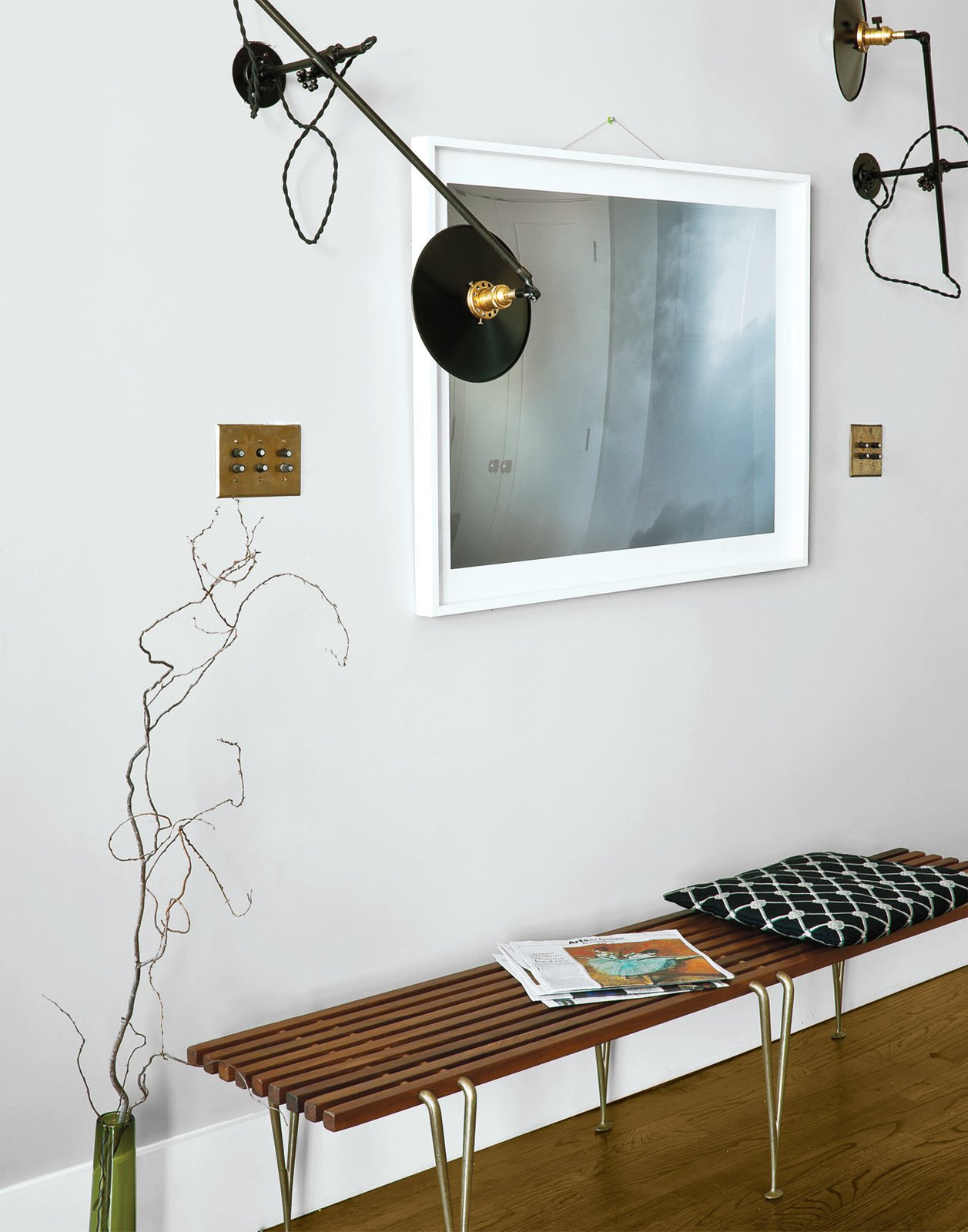 Workstead wall-mounted lamps illuminate a photo from Cloud Series by Matthew Williams. The bench is by Hugh Acton.  Photo 7 of 12 in A Minimal Yet Mighty Brooklyn Apartment