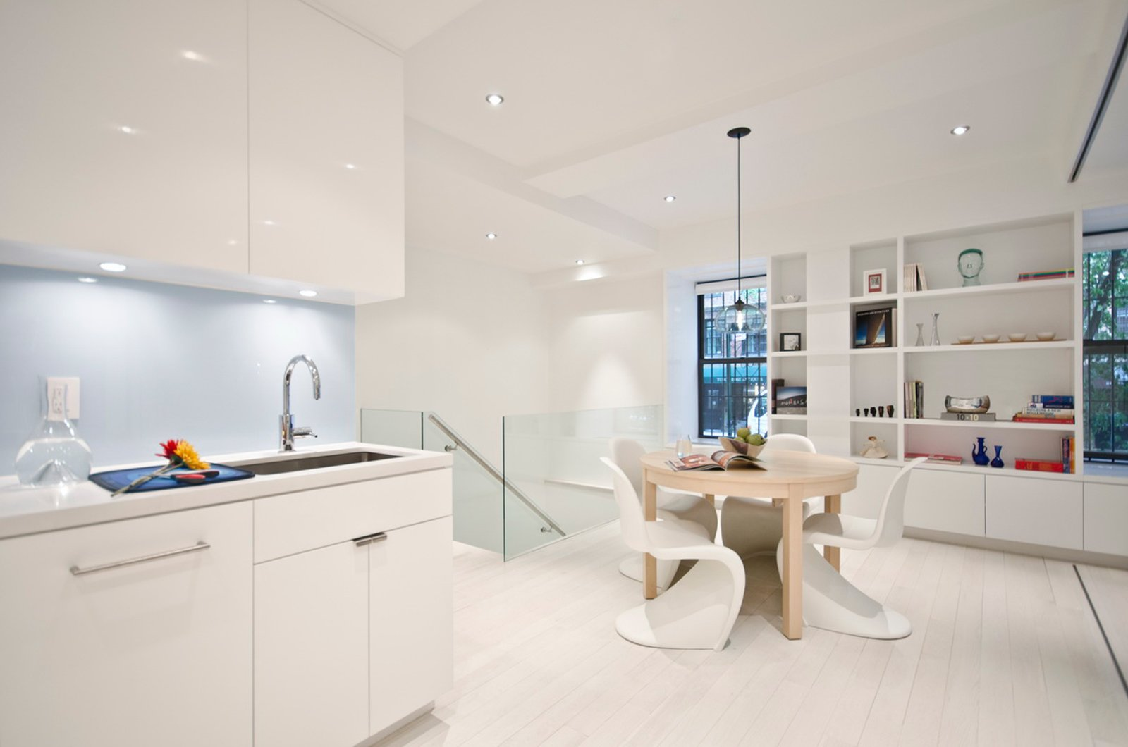 The kitchen was originally long, narrow, and completely closed off from the rest of the apartment. Miller opened up the plan to create a more spacious feel.  University Place Apartment by Diana Budds