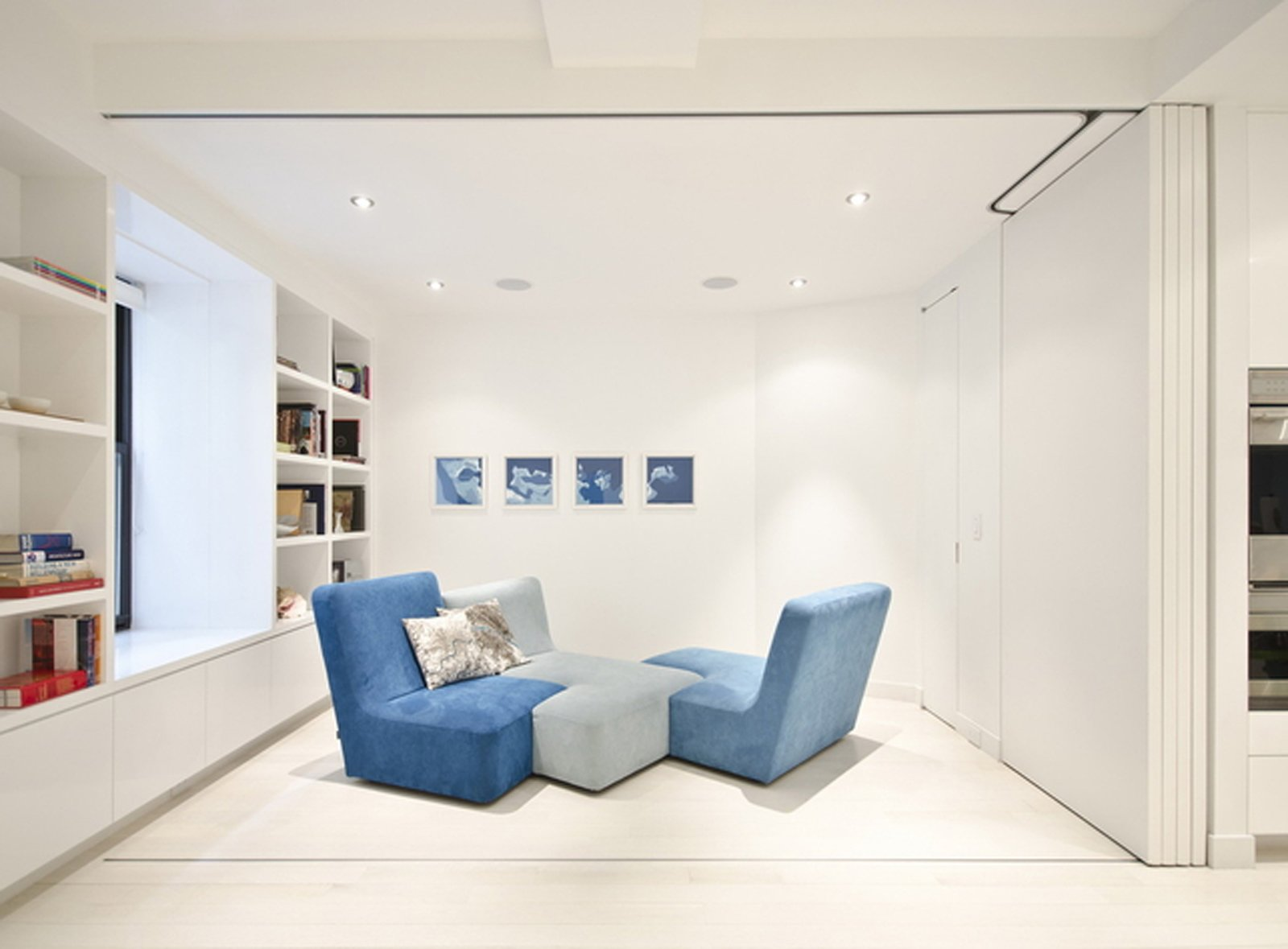 Here's the room with the doors fully opened. The sofa is by Ligne Roset.  University Place Apartment by Diana Budds