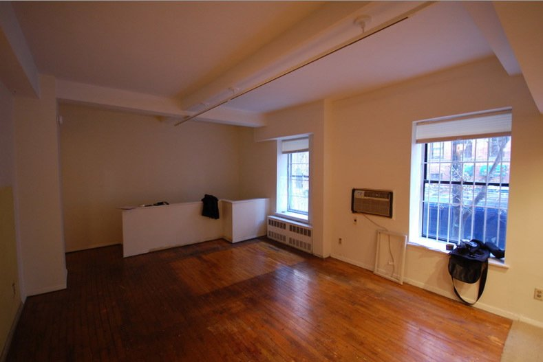 Here's what the living room looked like before.  University Place Apartment by Diana Budds