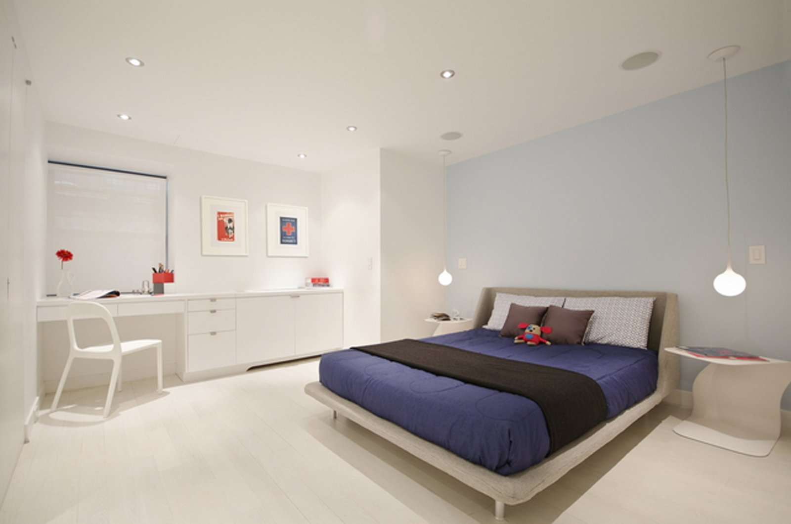 Here's the master bedroom on the lower level. The bed is from Blu Dot and the side table is by Mario Mazzer from Property Furniture.  University Place Apartment by Diana Budds