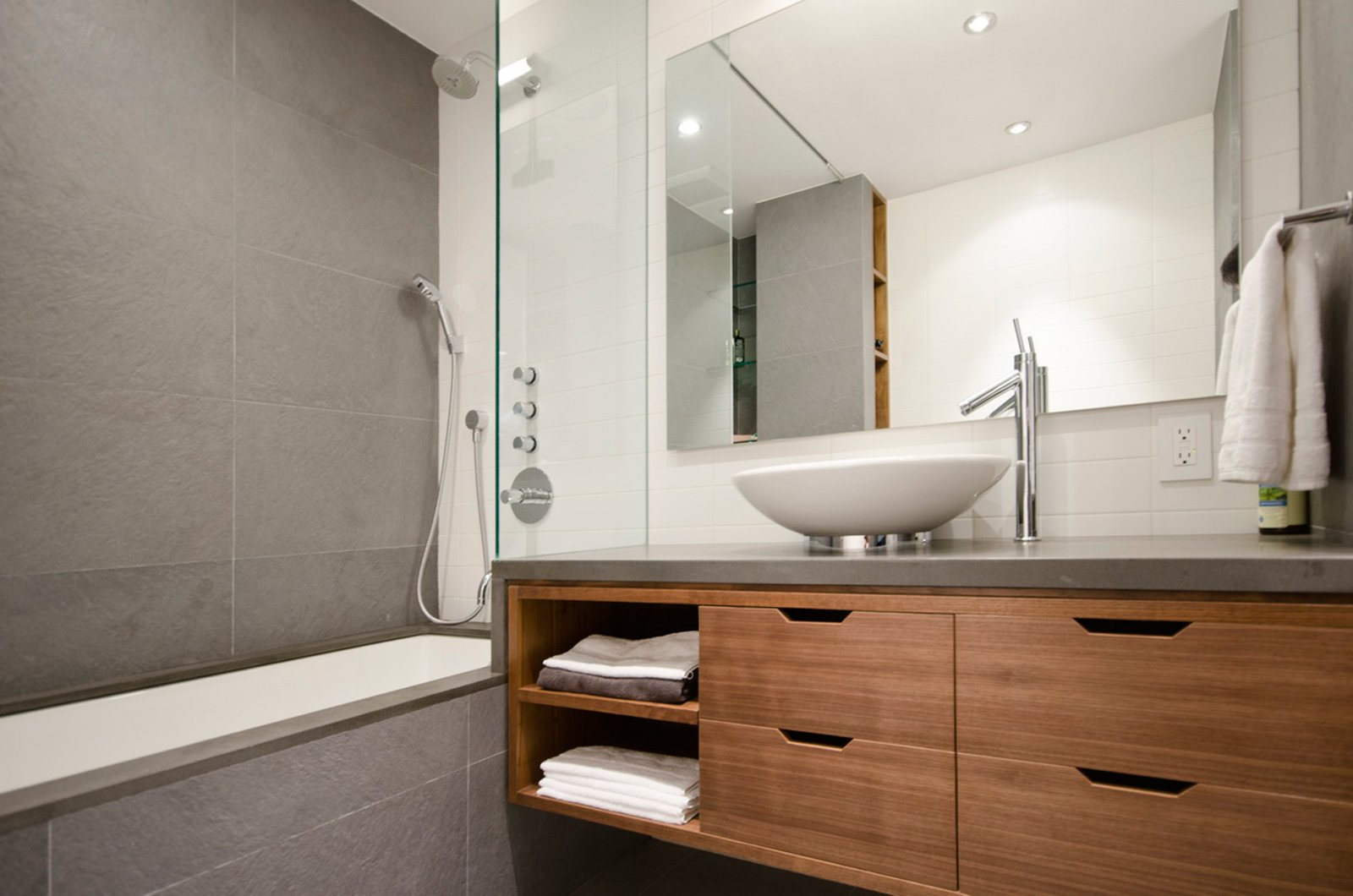 The bathroom features fixtures by Duravit and Hansgrohe.  University Place Apartment by Diana Budds