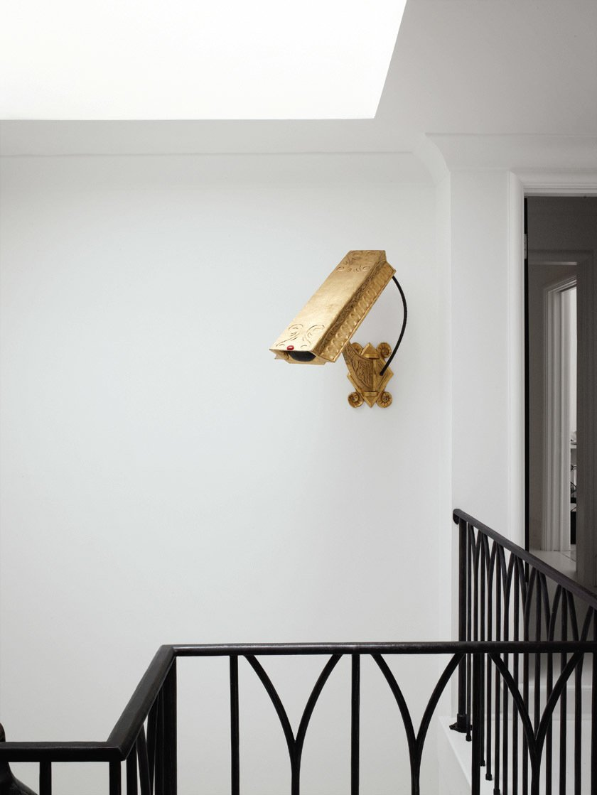 Windows and Skylight Window Type The gold (nonfunctioning) surveillance camera by artist Camp Bosworth in the stairwell previously hung in the glass entryway of the family's former house in Houston.  ARTE