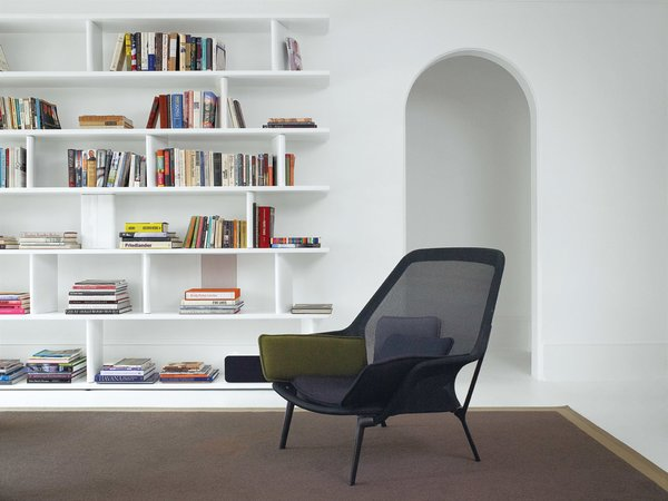 Vitra's Slow chair sits in front of a powder-coated-steel bookcase made by Hill's go-to fabricator, George Sacaris; it was originally built for the Houston house.