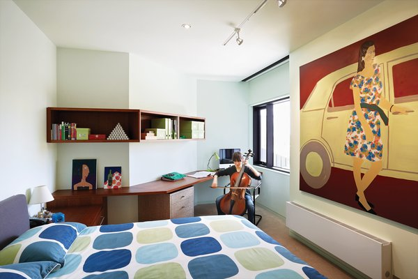 The Lyons' younger daughter practices cello in her bedroom, which overlooks the central gallery space.