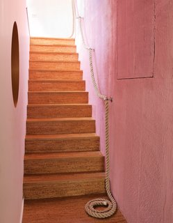 The cork stairs with a rope railing lead down to the kids' level.