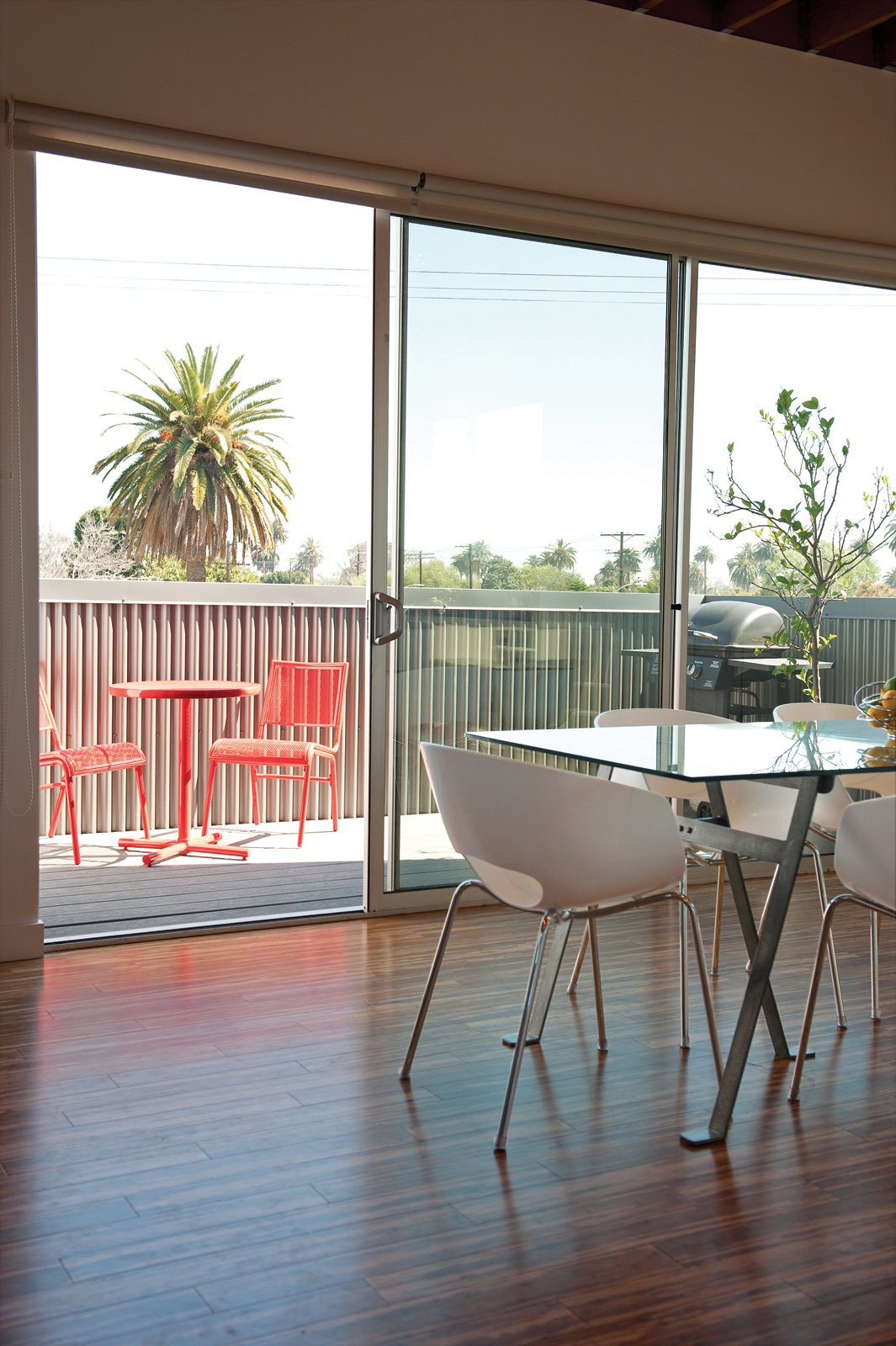 Her Lasalle patio set is from Target and her Engineer dining table and Orbit armchairs are from CB2.  Photo 5 of 13 in 131-Day House