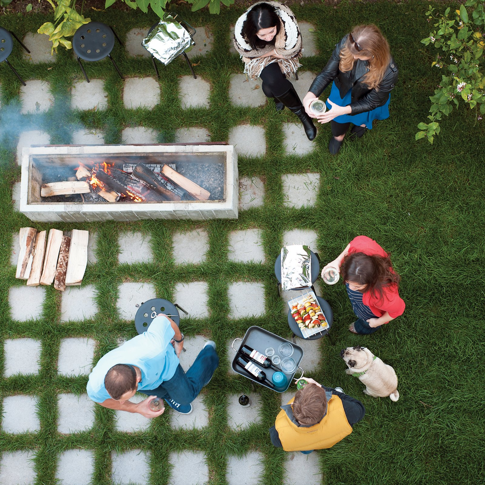 Outdoor, Grass, Pavers, and Back Yard The outdoor fire pit.  Best Outdoor Pavers Photos from 131-Day House