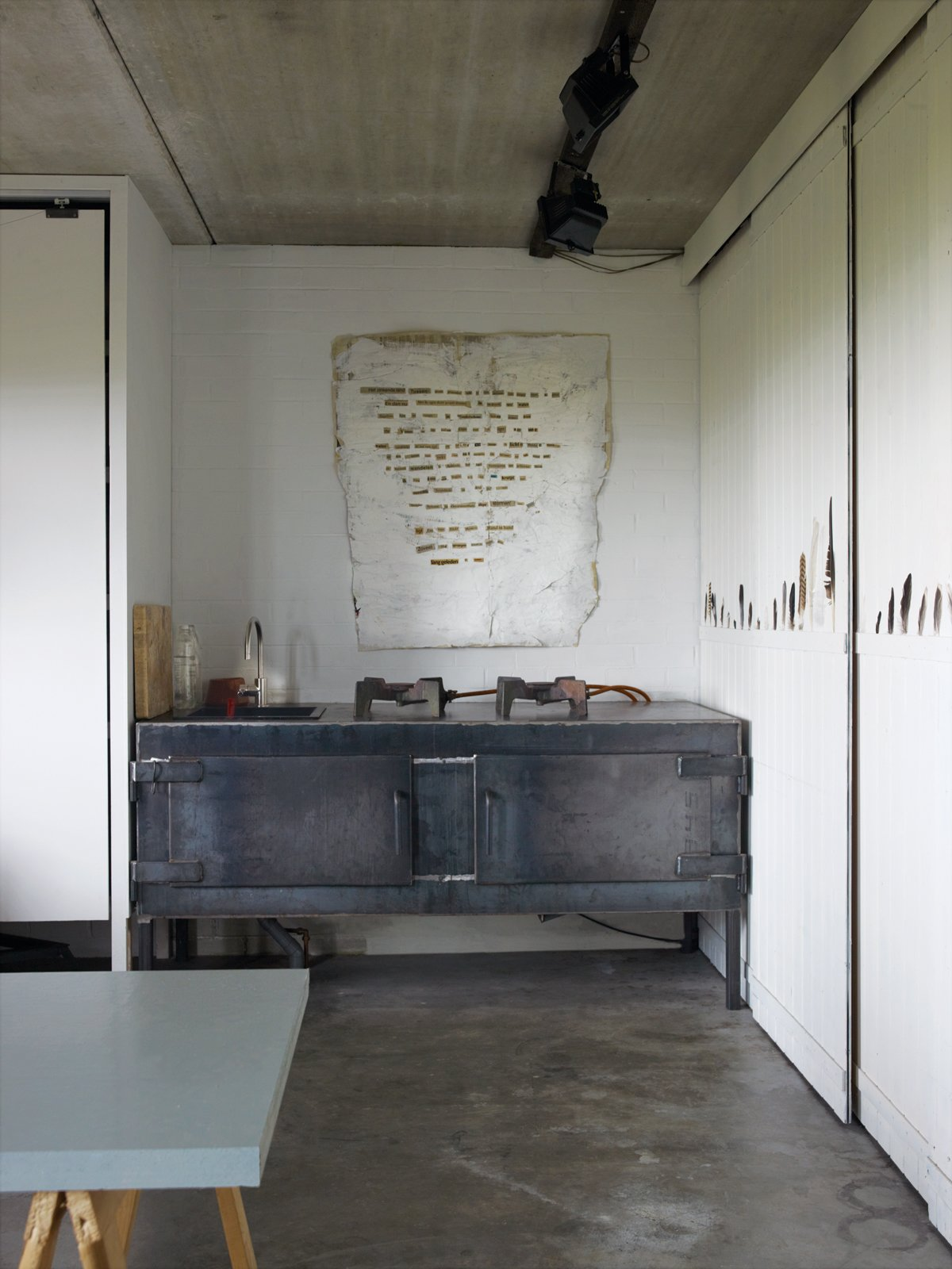 """Downstairs, in what was formerly a tractor garage, Leen created a felt-making studio and hangout space that she calls, in her creative English-as-a-third-language way, """"the chill room of me.""""  Photo 10 of 15 in Rural Home on a Holland Harbor"""