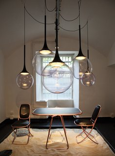 Spazio Rossana Orlandi is a sprawling space, a former tie factory that now holds a series of rooms, each one outfitted by a different designer. In one area, Slovenian designer Nika Zupanc's blown-glass pendants hang above her Summertime collection.