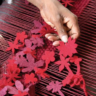 Little Field of FlowersTake a passage to India with Barcelona-based rug designer Nani Marquina as weavers transform a Tord Boontje sketch by warp and weft into a blossoming field of woolen flowers.  Featured in the   July / August 2008 issue.
