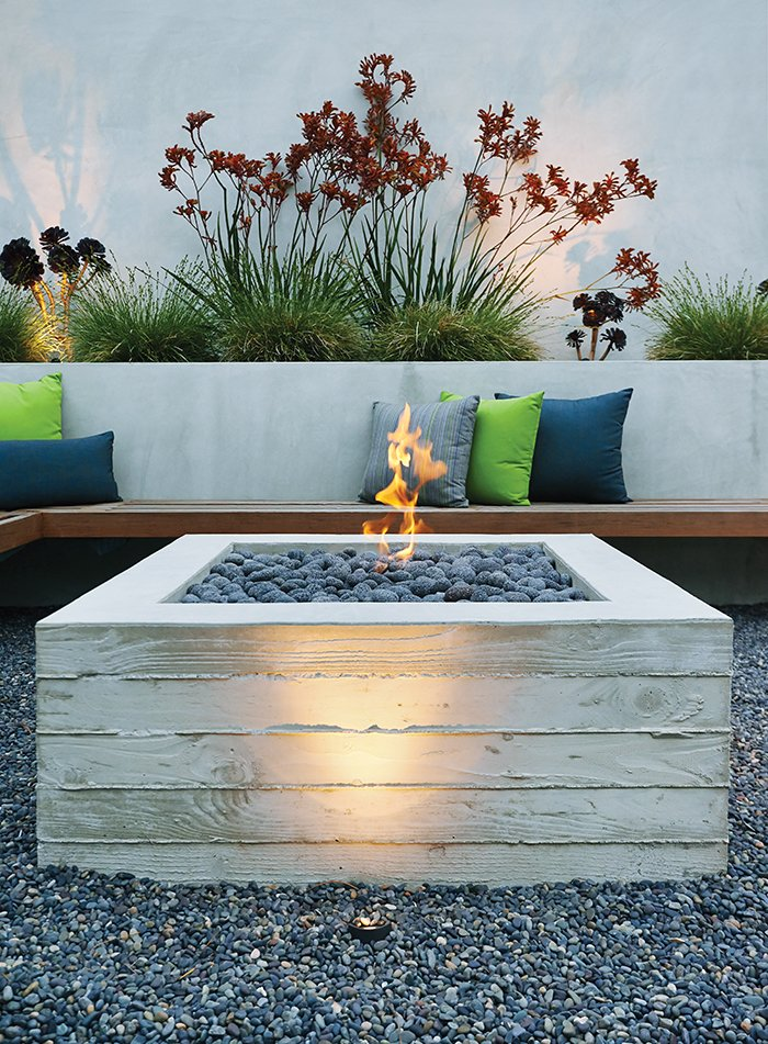A cantilevered ipe bench hugs a custom board-formed concrete fire pit.  My Photos from A Craftsman-Style Bungalow is Turned Inside Out
