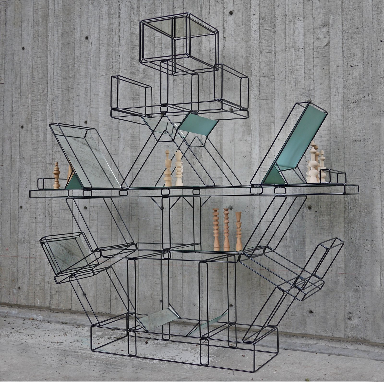"""Totem after Ettore Sottsass by Edgar Orlaineta (2013)  An example of Latin American craft that """"[presents] a response and challenge to international icons,"""" according to curator Lowery Stokes Sims, this wire-framed shelving system by the Mexican artist is a playful take on Ettore Sottsass's iconic Carlton bookcase.  Photo 5 of 12 in The New Language of Latin American Design"""