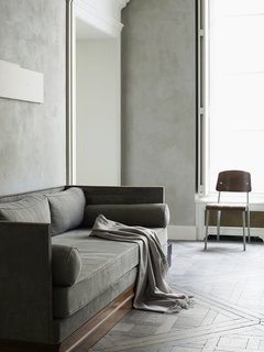 The color motif extends through Dirand's living room. The paint's suede effect catches the light and adds texture.